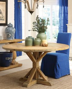 Round table to seat 8 looks cozier than seating 12 around a bigger