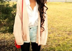 Cute peach cardigan, white blouse, shorts & tights.