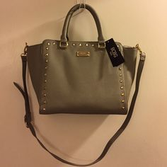 Purse Brand new with tags BCBG purse with studs. Comes with attached little coin purse and has a long strap also with handles. BCBG Bags Totes