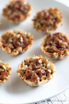 Mini phyllo cups filled with basil, garlic, creamy goat cheese, chopped pistachios, crumbled applewood smoked bacon and topped with a honey-balsamic glaze.