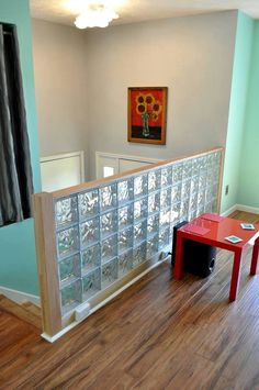 Glass block wall built to replace the colonial stair ballister. Another option is to use finishing blocks on the top and sides of the wall - here's how http://innovatebuildingsolutions.com/products/glass-block/glass-block-walls-bars