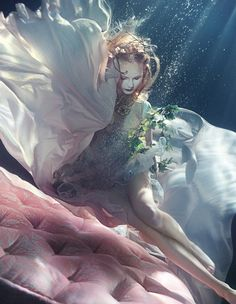 Underwater shoot by Zena Holloway [Emporio #Armani SS14 silk-organza dress with pearl suspenders]