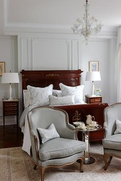 Sarah Richardson London Flat Master Bedroom. good furniture arrangement - two chairs and small table at the foot of the bed. better than a bench?