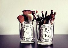 Dyptique candles repurposed as makeup brush holders