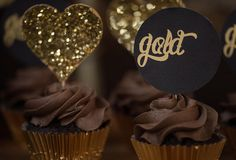 Cupcakes at a Hearts of Gold Party via Kara's Party Ideas KarasPartyIdeas.com. I love the gold & chocolate colors together.