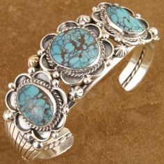 [Non Native Made] This Native American style turquoise bracelet features three beautiful Bisbee II free form cabochons. With a mix of matrix and spider webbing, these stone are truly unique and one of a kind. Each stone is carefully surrounded with Sterling bezel work and twist wire rope. Made by master Silversmith, Peter Hackert, the skill & talent needed to create this beauty is apparent in every detail. $400.00 #Alltribes