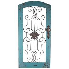 Distressed Turquoise Wood & Metal Wall Decor. A nice mix of the two natural elements wood and iron.