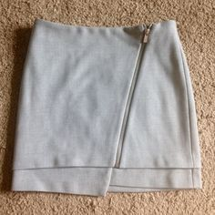 H&M grey a line skirt with zipper detail! Super cute and edgy light gray skirt by h&m. Size 2. Great condition. H&M Skirts Mini