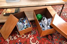 Love these leather boxes to hide toys in under the coffee table!!
