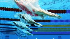 Jolien Sysmans of Belgium dives into the water at the start of the Women's 50m Freestyle heat 7 on Day 7 of the London 2012 Olympic Games