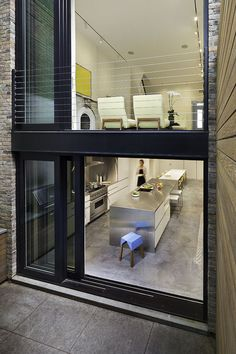 The rear of this house is virtually all glass, which ensures the 15-foot-wide structure doesn't feel claustrophobic.
