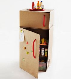 Stock this fab cardboard refrigerator with faux food for hours of pretend play. What you'll need: 16x12x28-inch box, 16x12x9-inch box, X-Acto knife, hot-glue gun, crafts knife, thick rope Make it: Assemble both boxes and place the smaller box on top of the larger box so the top of the larger box is the same length and width as the bottom of the smaller box; secure together with hot-glue gun. Use an X-Acto knife to cut the top, bottom, and right edges of the fro...
