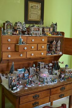 Christmas Village.  Like this once my kids are bigger and I can put the village down lower.