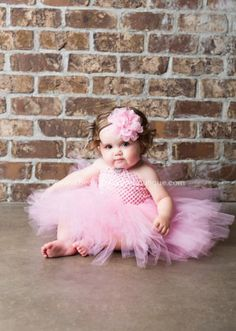 As fluffy as spun cotton candy, this solid light pink girl's tutu dress proves that the best things really do come in small packages! Designed in fine artisan detail, swath. Baby Tutu Dresses, Baby Girl Tutu, Baby Bows, Baby Dress, Flower Girl Dresses, Dress Set, Baby Girls, Baby Flower Headbands, Vintage Headbands