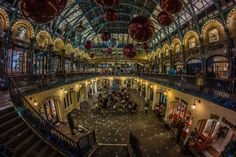 """Covent Garden - 8mm lens to squeeze it all in, he's captured the market as it currently looks (last week). Eight second exposure has really caught the festive mood (probably balancing the camera on the railing). Keeping ISO at 200 has also removed any sensor noise. A very attractive shot. """"A Night at the Opera"""" by Andrew Steel on 500px."""