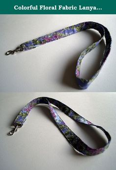 "Colorful Floral Fabric Lanyard or ID Badge Holder. Measuring 32"" around the neck and 1"" wide, go to work in style with this lanyard made from a pretty pink floral in purple, pink and green. A great small gift idea!."