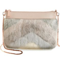 Chevrons of plush faux fur add of-the-moment edge to a slim leather crossbody bag fitted with an optional chain strap for styling versatility.