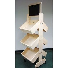 Wooden shelf displays are a popular option with merchants everywhere. Wooden shelves are perfect for gift-ware, clothing, and other retail items. Also, you can add containers for an instant classic retail display. Craft Fair Displays, Display Ideas, Craft Booths, Booth Displays, Store Displays, Booth Ideas, Soap Display, Yarn Display, Wooden Display Stand