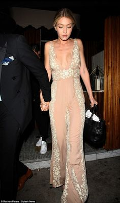 What a peach! Gigi Hadid takes the plunge in VERY low cut dusky pink jumpsuit as she enjoys an early birthday dinner with dapper beau Cody Simpson in West Hollywood on Friday night