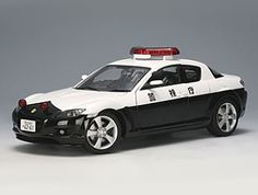 This Mazda RX8 Diecast Model Car is Black and White and features working steering, suspension, wheels and also opening bonnet with engine, boot, doors. It is made by AUTOart and is 1:18 scale (approx. 23cm / 9.1in long). ...