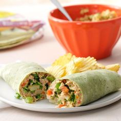 Crunchy Tuna Wraps Recipe -Packed with protein-rich tuna and fresh veggie crunch, these colorful wraps have sensational flavor…and they're good for you, too. —Edie Farm, Farmington, New Mexico Wrap Recipes, Fish Recipes, Seafood Recipes, Recipies, Salad Recipes, Canned Tuna Recipes, Cooking Recipes, Healthy Recipes, Cooking Ideas