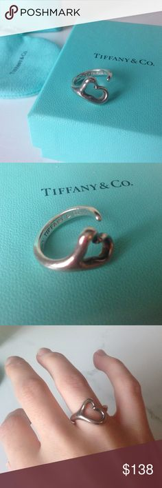 Open heart Tiffany and co ring Pre-owned condition open heart from Tiffany and co, some scratches up close, and perhaps a ring cleaning would help, otherwise still looks good. Sterling silver, authentic Tiffany & Co. Jewelry Rings