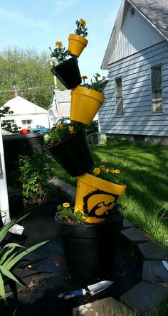 Leaning Pot Tower In Iowa Hawkeye Paint Scheme Nothing I Would Ever Want My Yard Maybe Sarah Betts Or Lindsay Petersen
