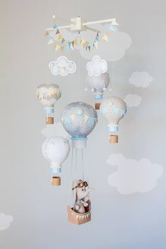 Hot Air Balloon Baby Mobile, Elephant Mobile, Baby Boy Nursery Decor, Latitude Longitude Decor, Travel Theme Nursery This beautiful baby mobile is gray, yellow, white, and blue. It hangs from a wooden top (white shown) with two puffy white clouds, two hand strung bunting flags