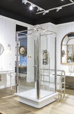 The Test Freestanding Shower, a self contained shower unit with cast iron base for an all over drenching #luxury #showering #bathrooms #design #brass #cast #iron #wood #paneling
