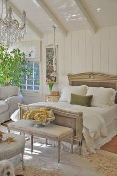 nice beams, elegant but not overdone bed frame, simple white linens, I like the simple elegance