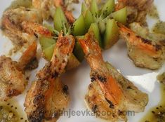 Grilled Prawns with Burnt Kiwi Chutney: Marinated prawns grilled to perfection and served with freshly made burnt kiwi chutney. Kiwi, Grilled Prawns, Sanjeev Kapoor, Chutney, Food Videos, Health And Wellness, Shrimp, Seafood, Vegetarian Recipes