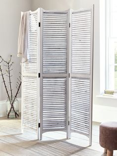 Transform any space with our large, versatile three panelled wooden screen. Beautifully crafted from natural fir wood with a whitewash finish and carved top, each slatted screen has stylish distressed details with knotted wood and a rustic uneven finish. Use to create different spaces in your bedroom or dressing room, or to hide away clutter in larger living spaces.