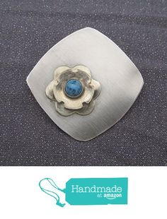 Silver Metal Turquoise Stone Flower Brooch from FirednWiredJewelry…