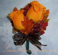 Boutinneer or corsage, love the leaves and colors