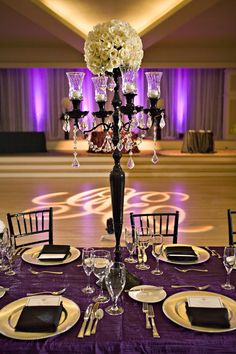 love this setup with a lovely centerpiece gobo monogram and beautiful beautiful color table uplighting