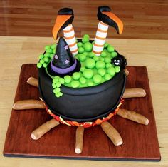 I love the cute simplicity. Makes me want to make a large cauldron cake.  Cake Wrecks - Home - Sunday Sweets: Halloween Treats