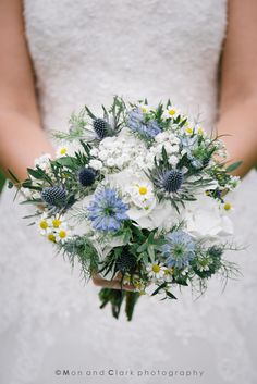 White and blue textured bridal bouquet.