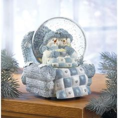 Snow Buddies Musical Snowglobe from KoehlerHomeDecor.com.  Cuddled up in the big chair together these love birds enjoy the medley of love songs!   Buy wholesale at Koehler Home Décor.