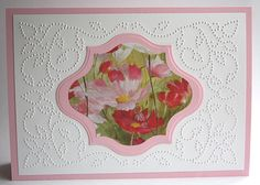 beatiful card with pierced design and die cut frame filled with flower image from a calender...