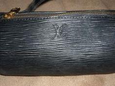 $150  Louis Vuitton Epi Black Cocktail Bag