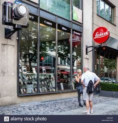 Download this stock image: Red Leica sign outside camera shop in Fasanenstraße, Berlin - da4cdp from Alamy's library of millions of high resolution stock photos, illustrations and vectors.