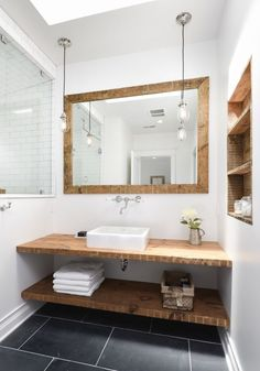 10 Tips: A Michigan Lake House by Linc Thelen - Slate flooring and a custom vanity of reclaimed wood hita subtle nautical note inthe master bath. Bathroom Vanity Designs, Bathroom Ideas, Vanity Bathroom, Wood Counter Bathroom, Reclaimed Wood Bathroom Vanity, Bathroom Renovations, Bathroom Storage, Wood Mirror, Mirror Floor
