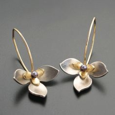 Layered lotus earrings in sterling, 14k and purple cultured pearl. 14k gold filled ear wires. $300.00