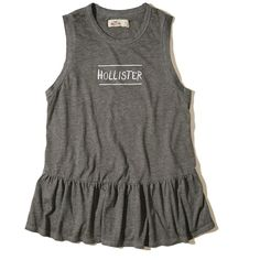 Hollister Ruffle-Hem Graphic Tank ($17) ❤ liked on Polyvore featuring tops, grey, loose fitting tank tops, gray tank top, graphic tanks, loose tank and loose fit tank
