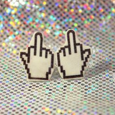 1 pair of Middle Finger Cursor studded earrings. Measures 1.5cm Item ships 1-5 business days from New York City.