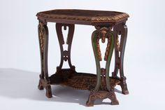 A Tortoiseshell Veneered and Ivorine Inlaid Parcel-Gilt Wood Side Table Attributed to Maison Franck, circa 1920 24 ¾ in (63 cm) high, 26 in (66 cm) wide, 18 in (46 cm) deep cf. Erik Müllendorff, 'The Furniture and Interior Design of Maison Franck of Antwerp (1900-1962)', Furniture History, Vol. XXXVII, 2002, pp. 150-165 Art Deco in Europa, exh. cat., Palace of Fine Arts, Brussels, 1989, p. 71