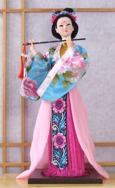 Chinese traditional hand made doll with flute in turquoise pink dress - Gifts Of The Orient