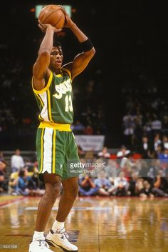 Kendall Gill #13 of the Seattle Supersonics looks to pass the ball during a NBA basketball game against the Washington Bullets on December 2, 1993 at USAir Arena in Landover, Maryland.