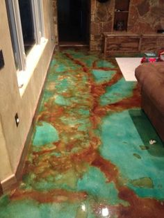 to Apply an Acid-Stain Look to Concrete Flooring Acid stain concrete - love it bc it looks like turquoise.holy moly this is awesome!Acid stain concrete - love it bc it looks like turquoise.holy moly this is awesome!