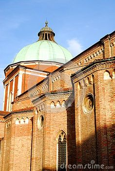 Photo taken at the cathedral of Vicenza in Veneto (Italy). In the picture you see, than the facade, the portion of the left side of the Santa Maria Cathedral of the Annunciation near the apse illuminated by the setting sun. The dome light color stands out against the sky.